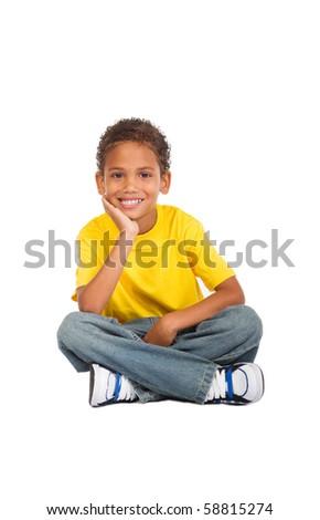 african kid boy sitting on floor - stock photo