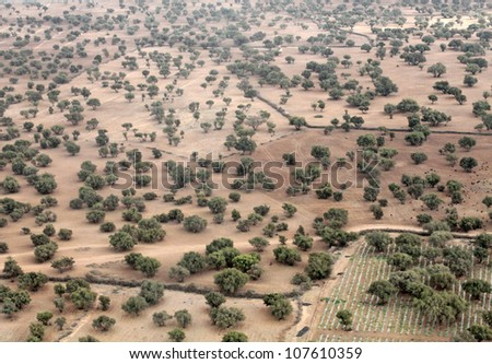 African landscape: view of earth from an airplane window - stock photo