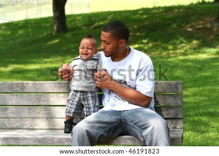 African Latin Toddler with African American Man - stock photo