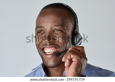African male customer service personnel operator smiling with microphone headset