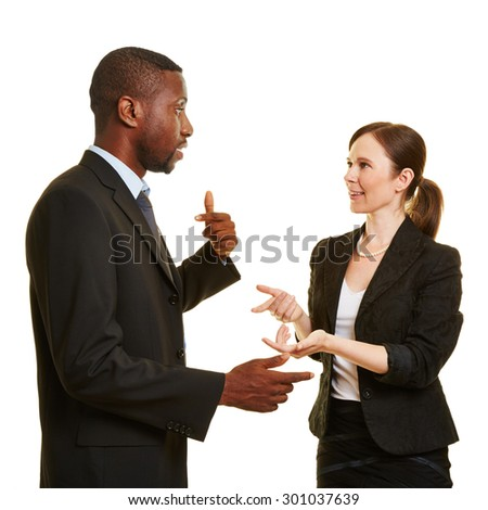 African man and caucasian woman talking together as businesspeople