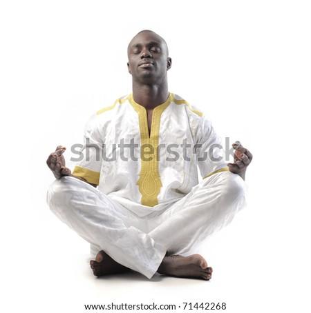 African man doing yoga - stock photo