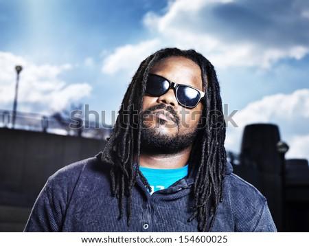 african man in urban portrait. - stock photo