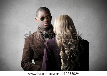 African man meeting a mannequin - stock photo