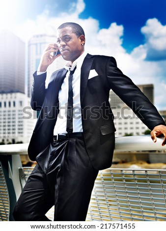 african man on smartphone in suit
