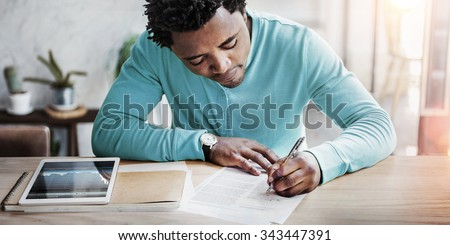 African Man Planning Stock Exchange Writing Concept - stock photo