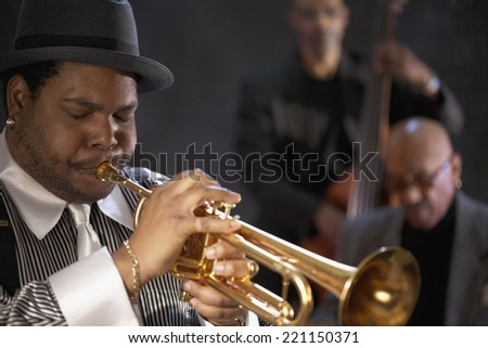 African man playing trumpet - stock photo
