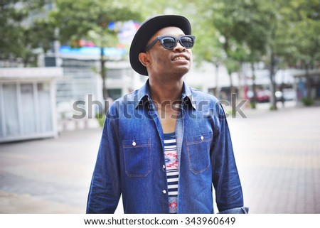 African Man Relaxation Outdoors Happiness Concept - stock photo