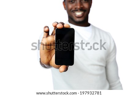 African man showing a blank smartphone display isolated on a white background. Focus on smartphone - stock photo