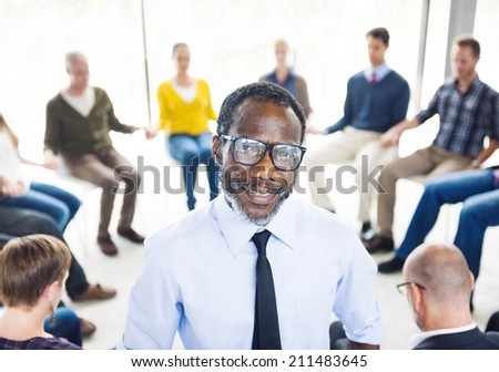 African Man Standing in Front of a Support Group - stock photo