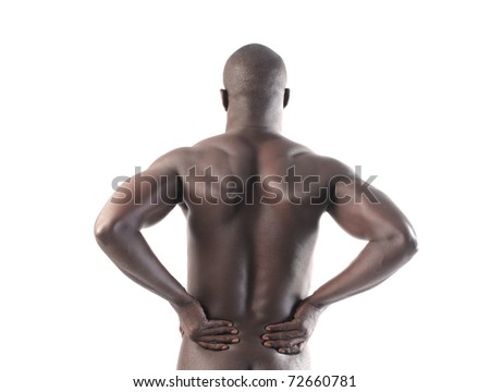 African man suffering from backache - stock photo