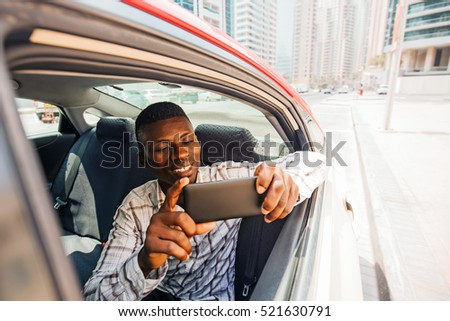 african man using maps or other location related app on a smartphone
