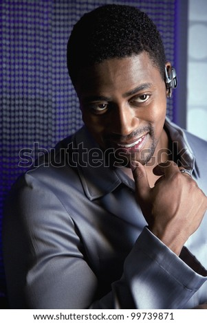 African man wearing hands free device - stock photo