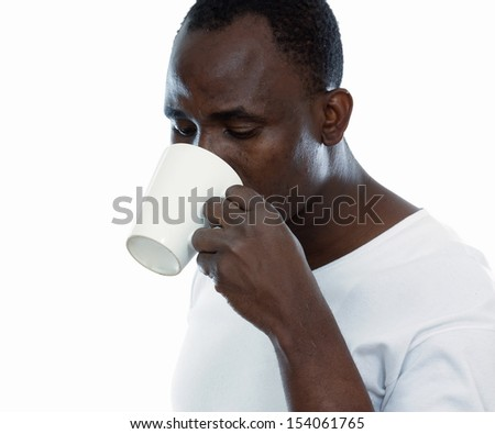 African man with cup of tea - stock photo