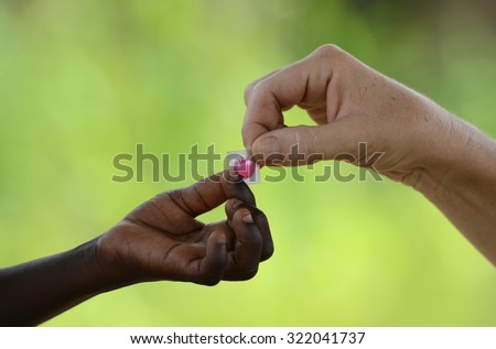 African Medicine Symbol White Woman Gives Stock Photo Royalty Free