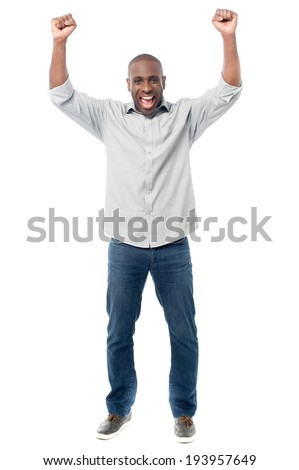 African middles aged man clenching fists - stock photo