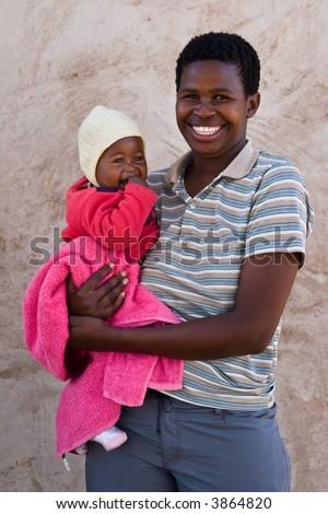 African mother and child, village near Kalahari desert, people diversity series - stock photo