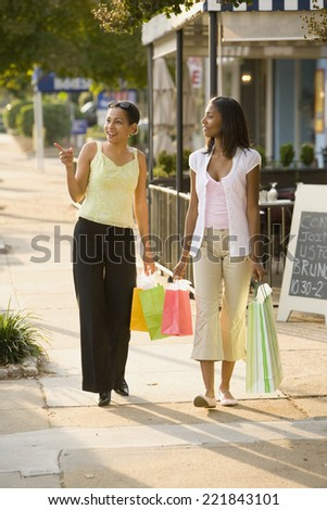 African mother and daughter carrying shopping bags - stock photo