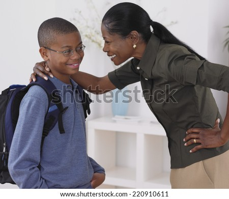 African mother hugging son - stock photo