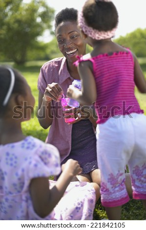 African mother smiling at daughters - stock photo