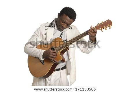 African musician playing guitar, Studio Shot - stock photo