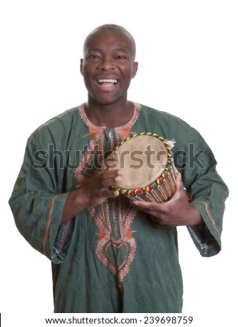 African musician with traditional clothes and drums - stock photo