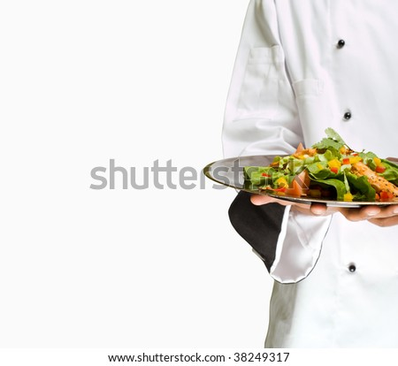 African or American chef presenting healthy food chicken salad - stock photo