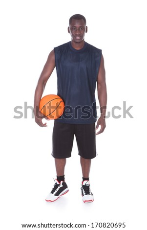 African Player With Basketball Over White Background