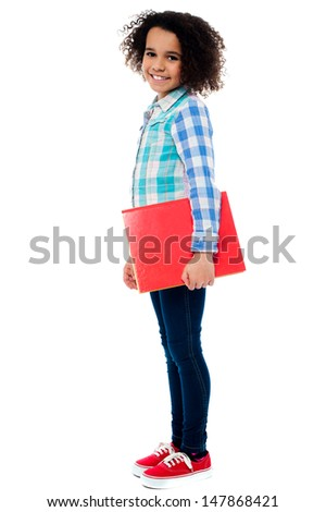 African school girl holding a notebook - stock photo