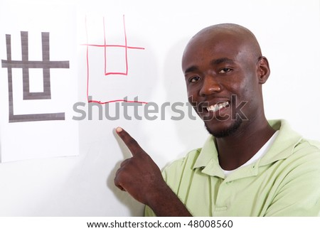 african student learning chinese - stock photo