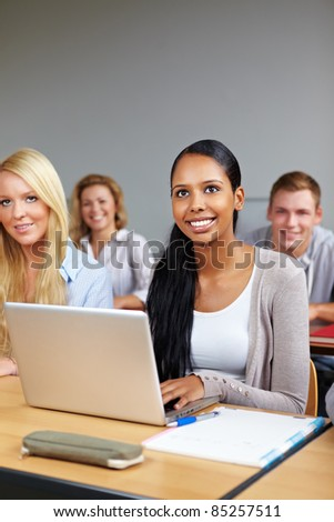 African student with computer in university class - stock photo