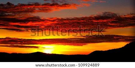African sunset in the Serengeti National Park, Tanzania - stock photo