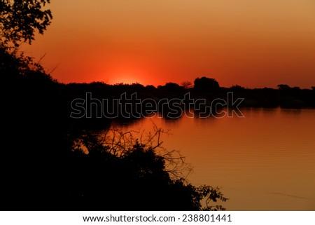 African sunset on Zambezi river, Caprivi region, Namibia - stock photo