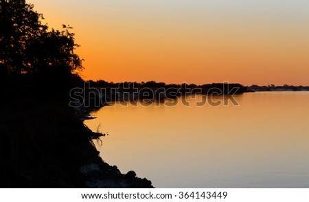 African sunset on Zambezi river, Caprivi strip region, Namibia - stock photo