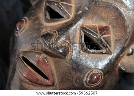 African Tribal Wooden Hand Carved Mask From Congo - stock photo