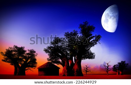 African village at night with big moon - stock photo
