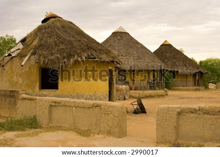 African village traditional huts, at the sunset, poverty, kgotla ( house of the chiefs ), Botswana, Africa - stock photo