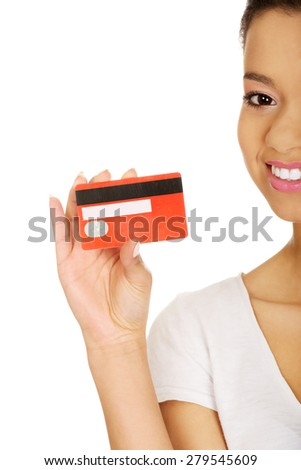 African woman holding a credit card. - stock photo