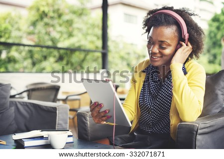 African Woman Listening Headphone Relaxation Concept - stock photo