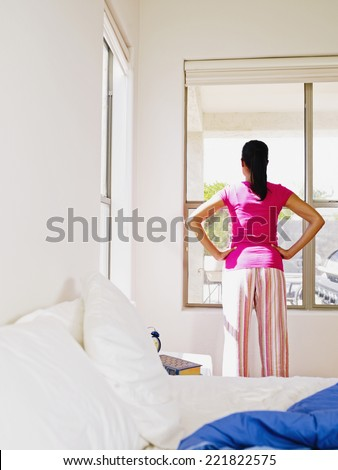 African woman looking out window - stock photo