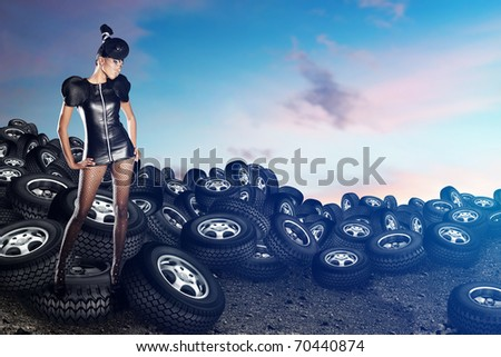 African woman on tires on the blue sky - stock photo
