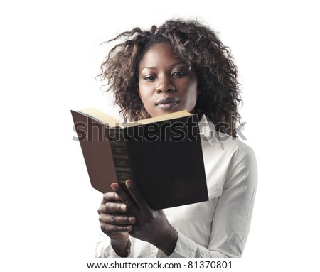 African woman reading a book - stock photo