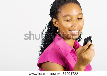 african woman reading text messages on cellphone
