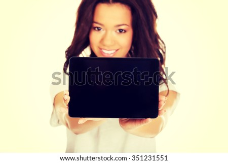 African woman showing tablet computer. - stock photo