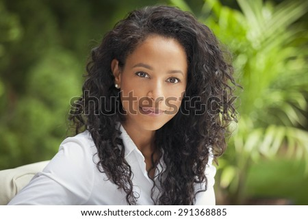 African Woman Smiling At The Camera - stock photo