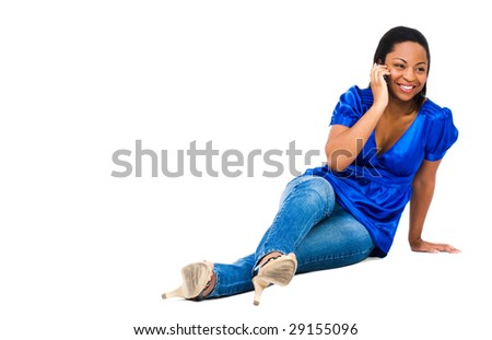 African woman talking on a mobile phone isolated over white - stock photo
