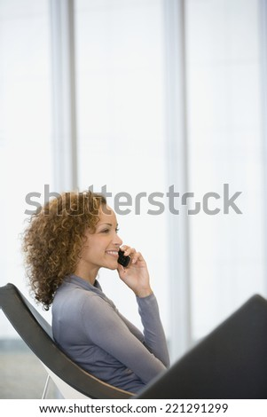 African woman talking on cell phone - stock photo