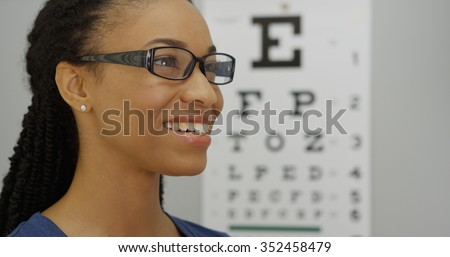 African woman trying on her new glasses