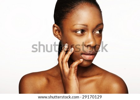 African woman with natural make-up head-shoot - stock photo