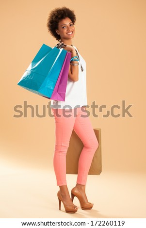 African Woman With Shopping Bags - stock photo